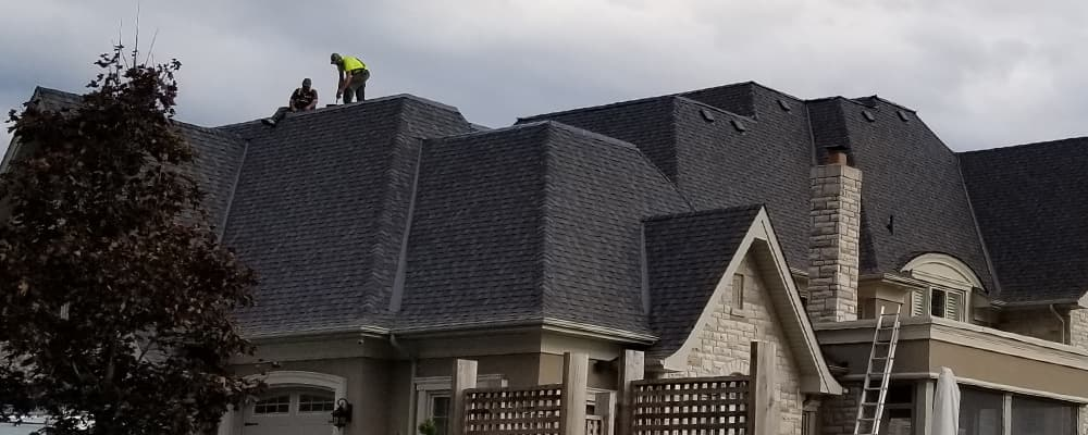 C.D. Roofing working on residential roof project in Oshawa installing a flat roof as well as shingle roofing