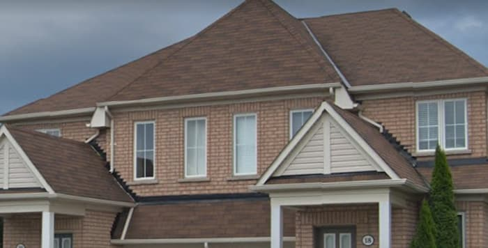 The redwood shingle we used matches the brick on this roof replacement in Ajax.
